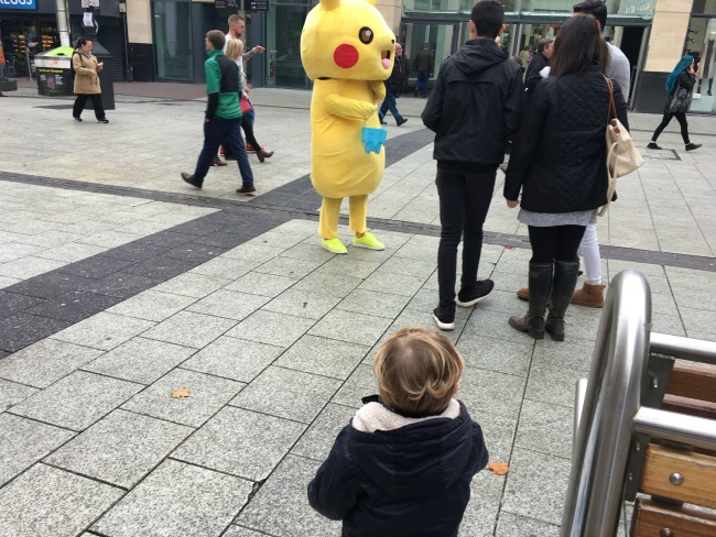 toddler-at-cardiff-city-centre-looking-at-yellow-pokemon-character