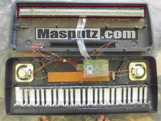 membongkar keyboard piano elektrik