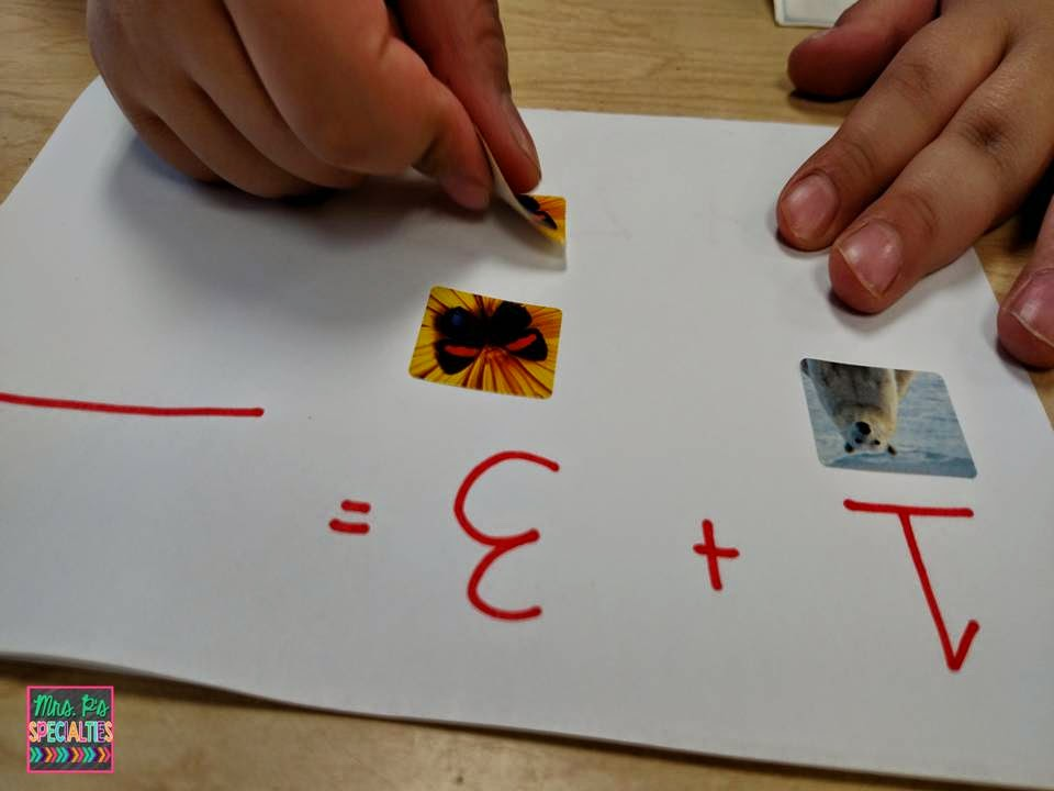photo of the student using stickers to create his sets before adding them all together.