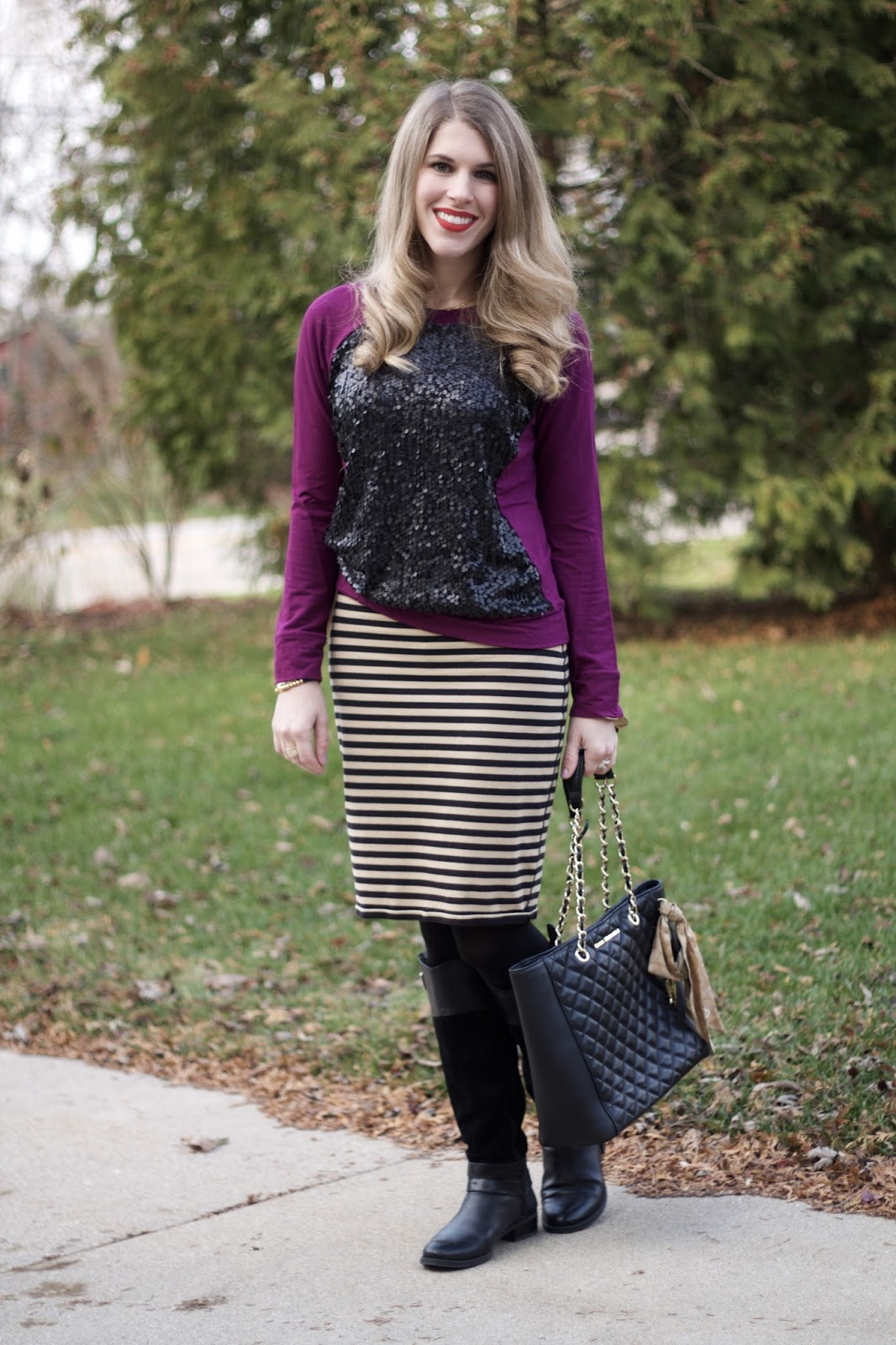 purple sequin sweater, black striped skirt, black boots, greg michaels tote