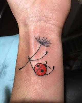 ladybug holding tree tattoo
