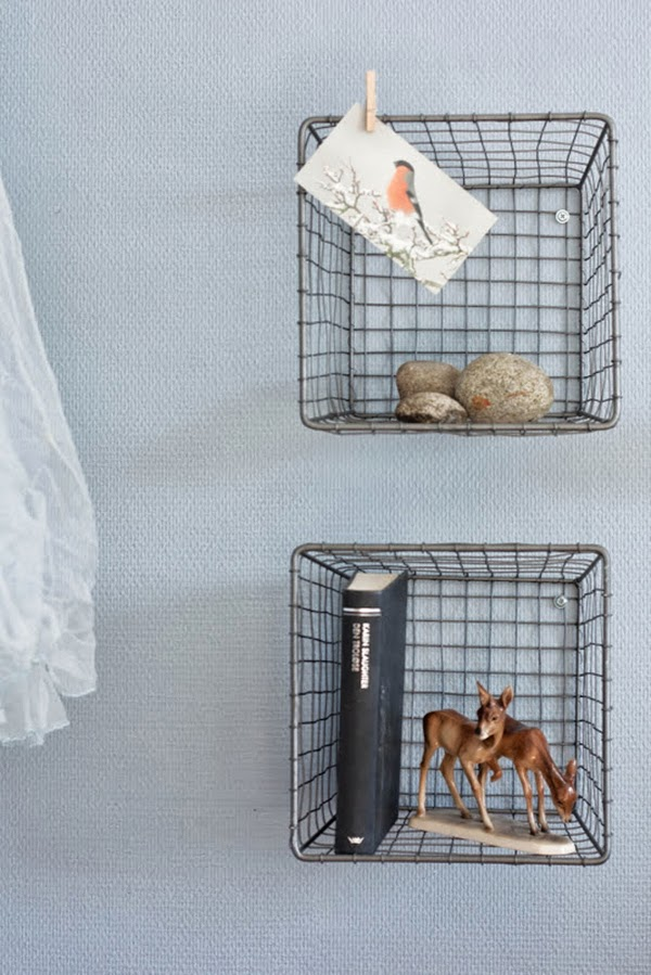 Using Upturned Wire Baskets, screwed to the wall and used as display storage