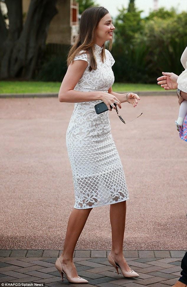 Miranda Kerr wore a white lace dress