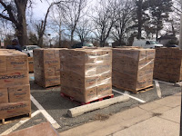Book cartons on pallets in parking lot