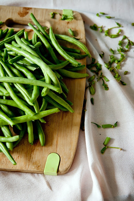 Preparing green bean on a wooden cutting board