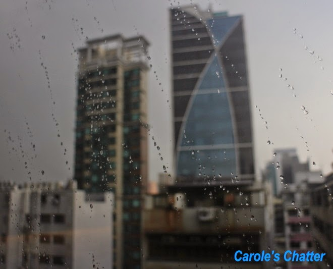 View from our room during thunderstorm in Hong Kong by Carole's Chatter