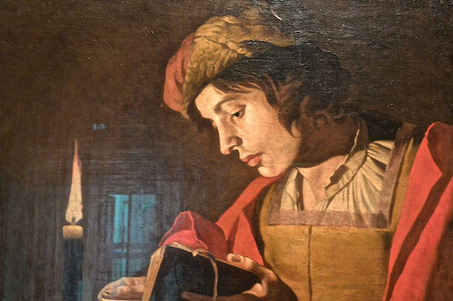 Stockholm: national museum : Matthias Stom (1600_1650) A young man reading by candlelight