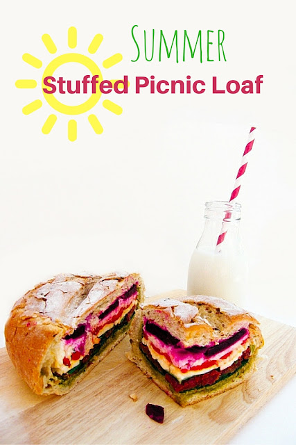 A bright and colourful picnic loaf, layered with delicious sandwich fillings and wrapped overnight for a self-contained picnic lunch that will bring a smile to everyone's face (with veggie and vegan options). Why not use this technique and try your own filling. It's perfect for summer lunches.