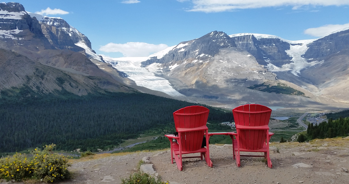 Two red chairs in Wilcox Pass at the Canadian Rockies hiking