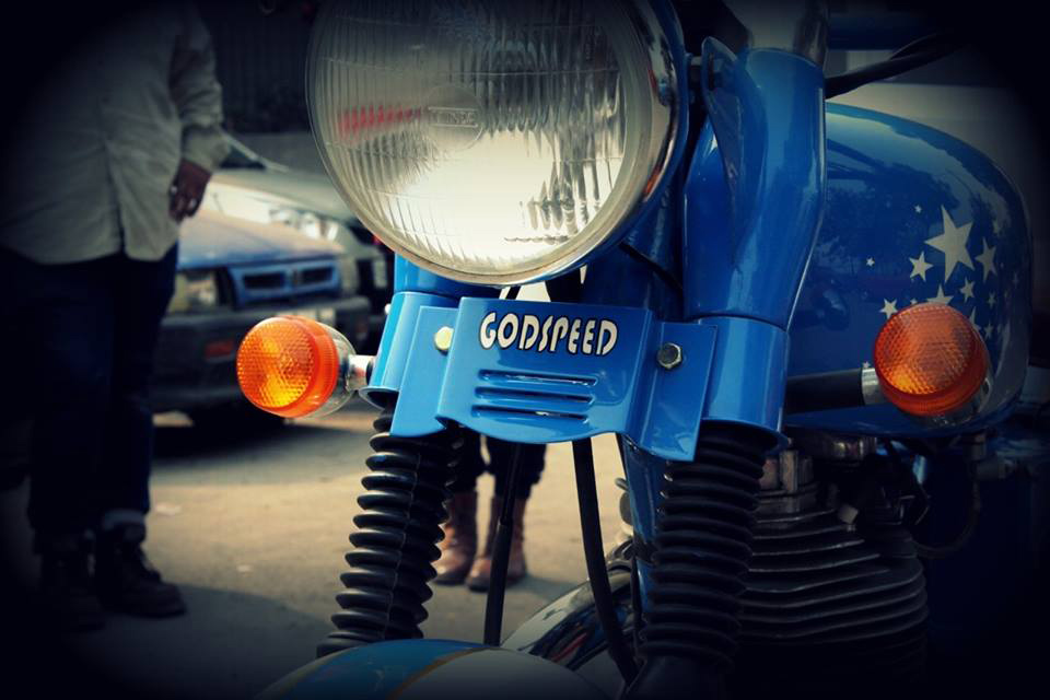 Name painted on Royal Enfield motorcycle.