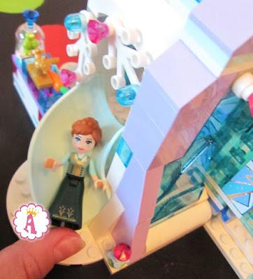 Анна съезжает с горки Лего