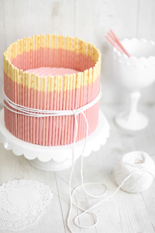 Taste Book Remember Pink Vanilla Pocky Cake | Sprinkle Bakes