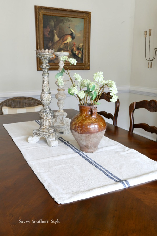 French country style centerpiece with Aidan Gray candlesticks and an antique vase