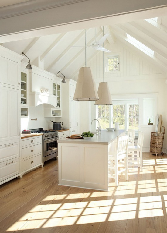 Oh, that sneaking sunlight! Amazing coastal loft style kitchen by Lisa Kauffman Tharp.