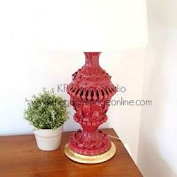 Lámpara de cerámica antigua con base dorada