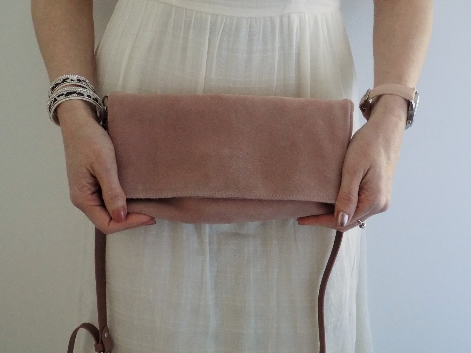 Pink suede cross body bag
