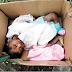 Photo: Mother Abandoned baby in carton near a refuse dump in Akwa Ibom State