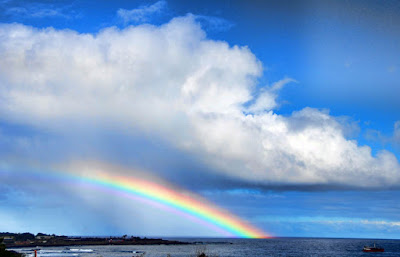 A rainbow is seen on Ankaro Bay in Easter Island, off the Chilean coast in the Pacific Ocean.