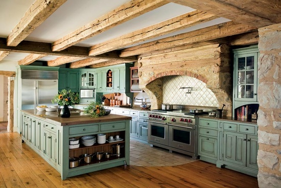 Love the turquoise cabinets ad grand wooden beams give this kitchen a wide open, grand look