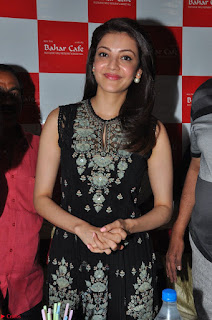 Kajal Aggarwal in lovely Black Sleeveless Anarlaki Dress in Hyderabad at Launch of Bahar Cafe at Madinaguda 017.JPG