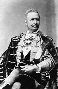 Geza Zichy, seated, in formal dress