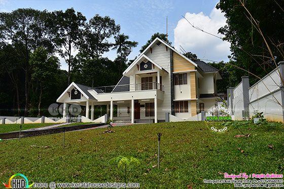 Interior finished 4 bedroom Kerala home plan