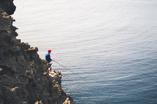 fisherman fishing cape zanpa zampa yomitan okinawa japan ocean
