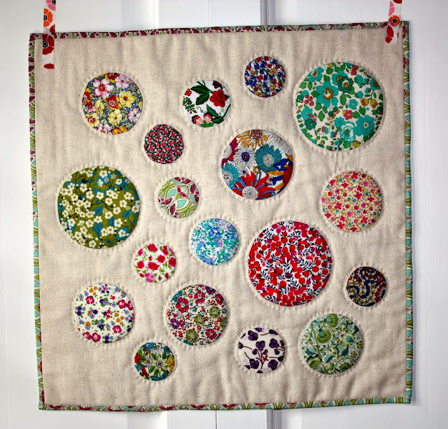 circle mini quilt, big stitch