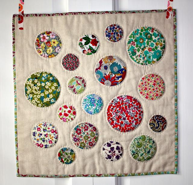 circle mini quilt, big stitch