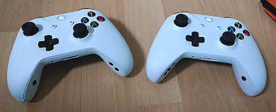 Two Xbox One white Joypad controllers lightened sticks and fitted with discrete switch sockets for Co-Pilot use.