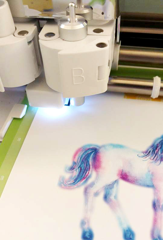 The cricut explore finds the registration marks and then cuts around all the sticker designs unload the mat and all your stickers are ready to use
