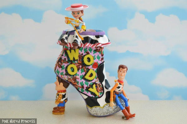 cloud wallpaper background with single ankle boot sitting with Jessie and Woody cowboy figures sitting atop