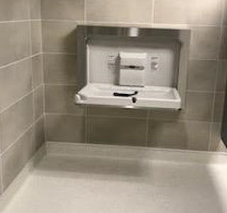 Restroom baby changing station, showing new wall and floor tile