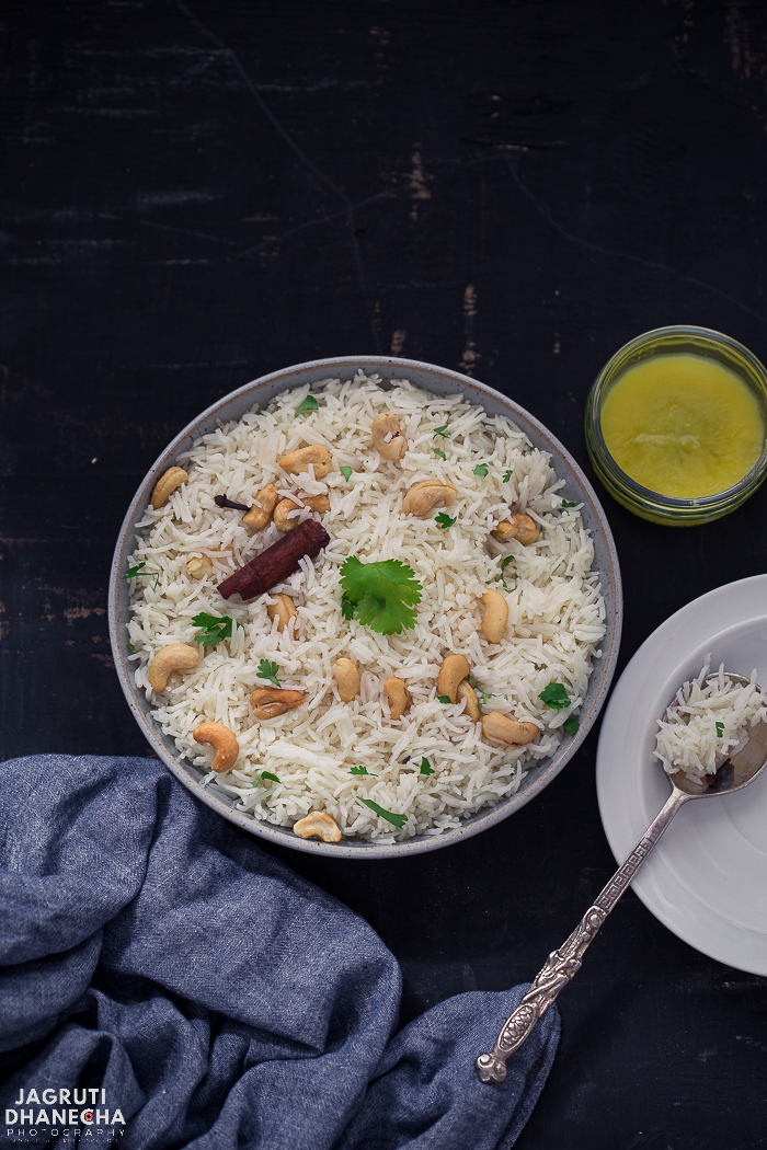 Ghee Rice is an irresistibly delicious, quick and straightforward classic Indian rice dish which is flavoured with Indian clarified butter, Ghee.  A super side dish that is made with a handful of ingredients and pairs well with any spicy Indian meal. Whether you prepare on stovetop, Indian pressure cooker or Instant Pot, you'll have perfect fluffiest cooked Ghee rice every time.