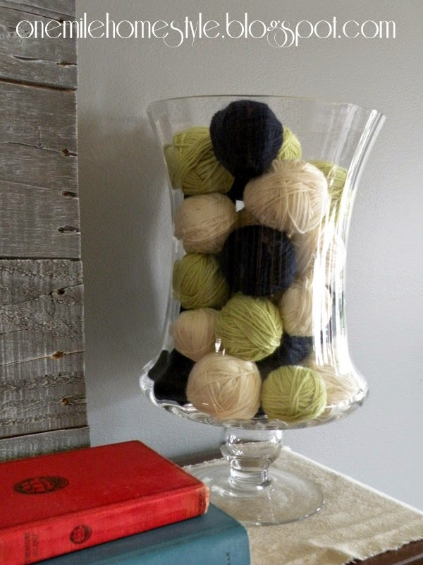 Yarn ball display in an oversized vase