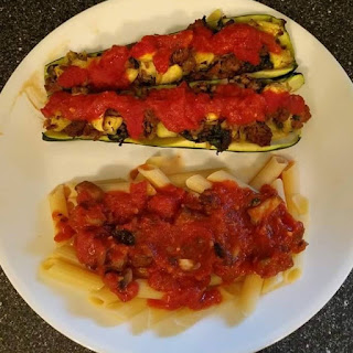 Stuffed Zucchini Boats on Plate with Pasta and Sauce