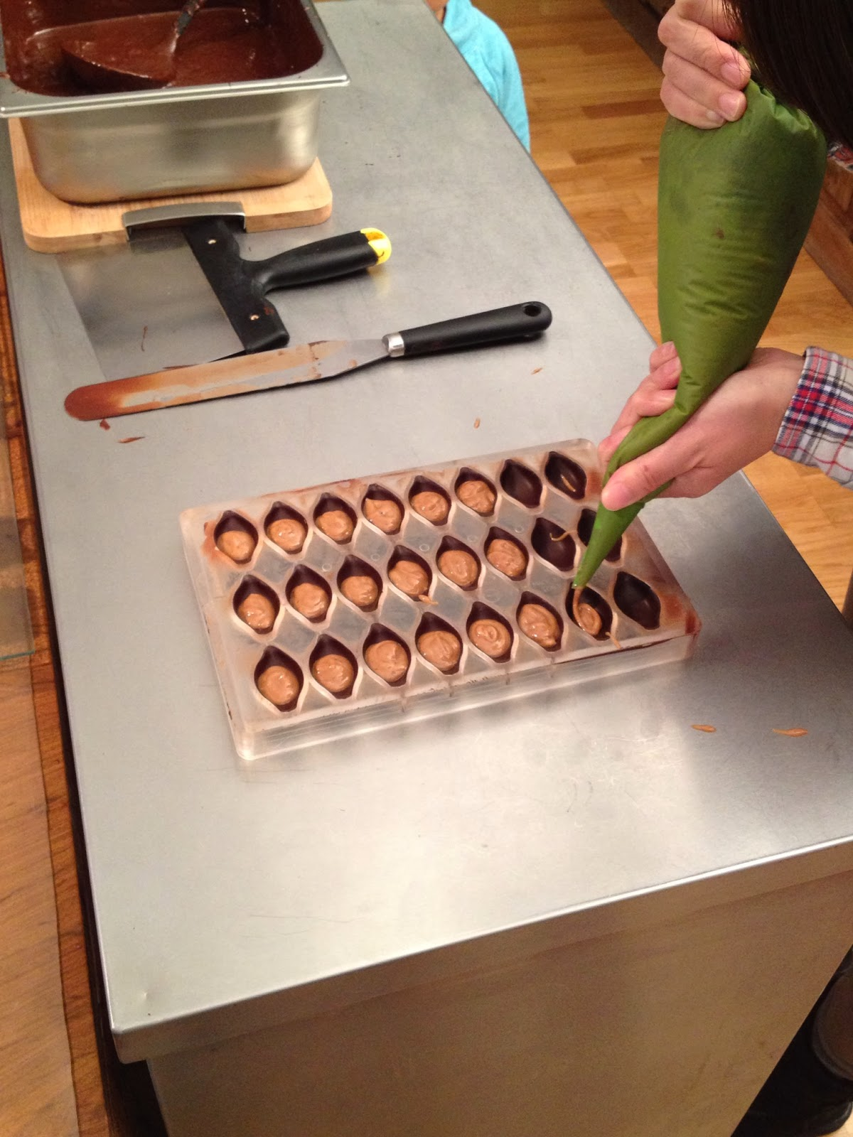 Brussels - Making hazelnut filled pralines during the chocolate tour