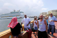Thousands of people evacuating Puerto Rico line up to get on a cruise ship in the aftermath of Hurricane Maria in San Juan, Puerto Rico, Thursday, Sept. 28, 2017. The aftermath of the powerful storm has resulted in a near-total shutdown of the U.S. territory's economy that could last for weeks and has many people running seriously low on cash and worrying that it will become even harder to survive on this storm-ravaged island. (Photo Credit: AP/Gerald Herbert) Click to Enlarge.