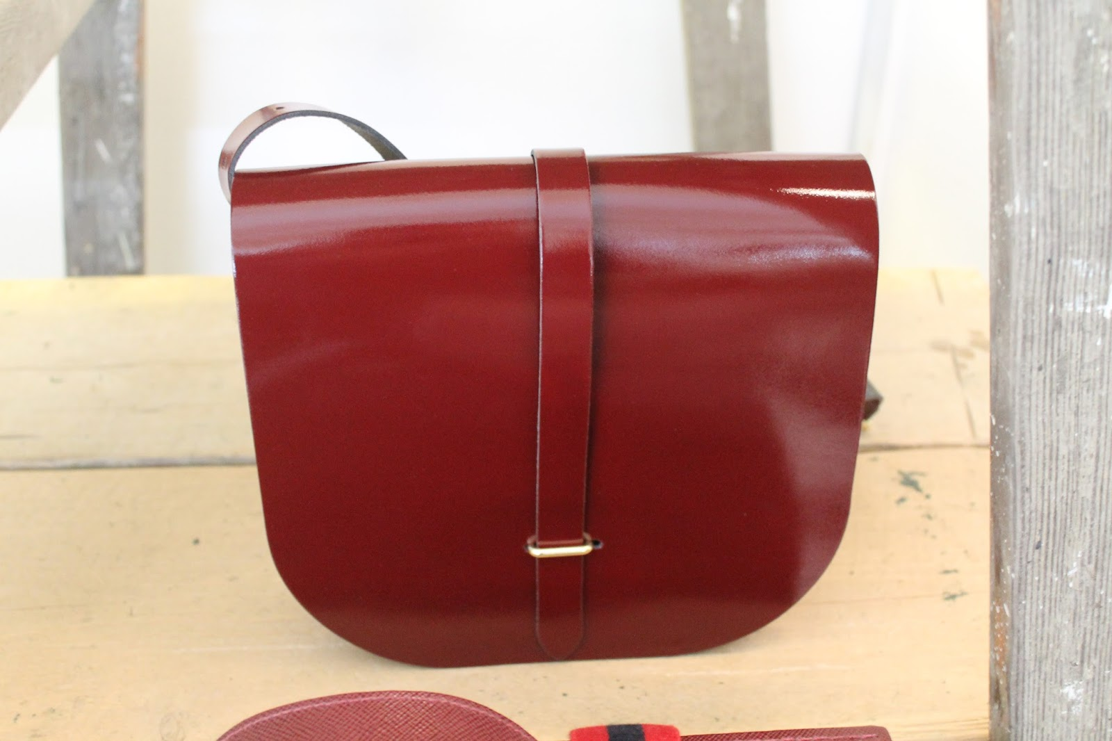 9eb01b3212e *In Store* This saddle bag in red colour leather is by The Cambridge  Satchel Company. It comes in 6 colours and dust bag and its style is taken  from the ...