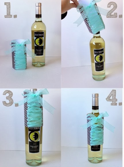 Bachelorette Party Wine Bottles - just pop the wrapping paper and ribbon sleeve over the top of the bottle and you're done! It's so easy to dress up wine bottles for a party.