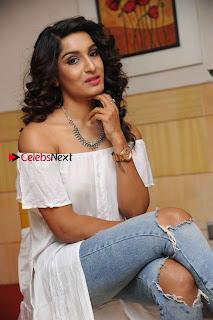 Kannada Model Actress Krishi Thapanda Stills in Ripped Jeans at Eradu Kanasu Movie Press Meet  0009.jpg