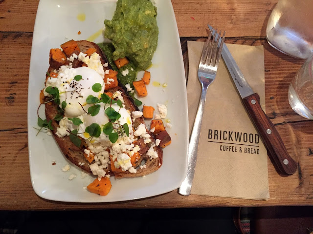 sweet potato w/poached eggs, feta, kale pesto and pine nuts on sourdough