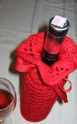 http://www.ravelry.com/patterns/library/penche-a-wine-bottle-cozy