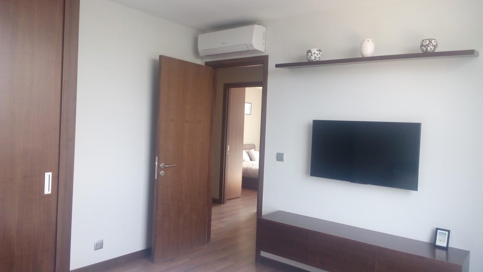 Hệ thống cửa gỗ Veneer Óc Chó tại chung cư Taseco Complex