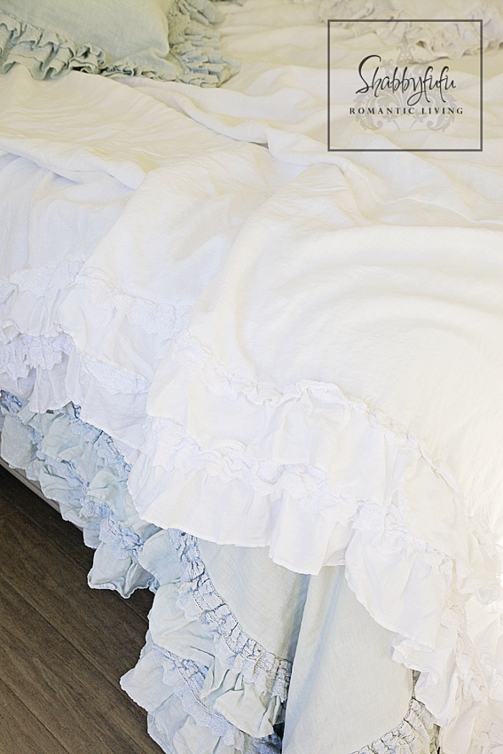 romantic room designs - soft white and blue ruffled bed linens