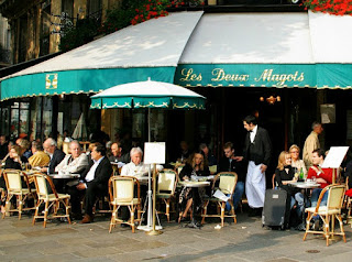 picture of people sat outside a cafe in Paris