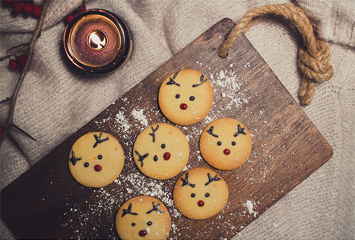 This picture shows Christmas cookies, that look like Rudolf the Rednosed Reindeer.