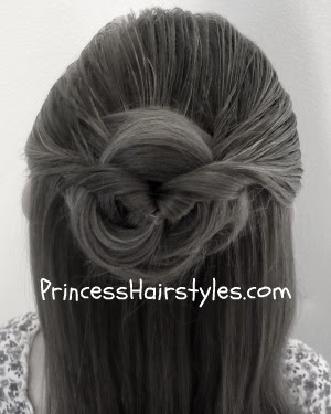 half ponytail topsy tail hairstyle