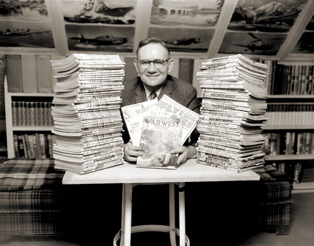 Unidentified collector with pulp magazine collection - Western, Aviation. Looks happy