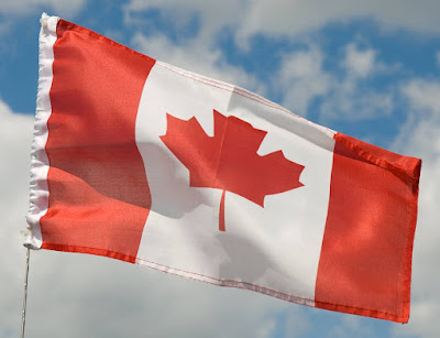 A small red and white maple leaf flag from Canada